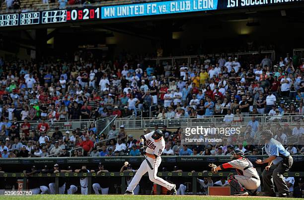 Max Kepler of the Minnesota Twins hits a walkoff threerun home run as Sandy Leon of the Boston Red Sox catches during the tenth inning of the game on...