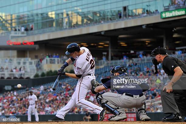 Max Kepler of the Minnesota Twins hits an RBI double as Curt Casali of the Tampa Bay Rays catches during the fourth inning of the game on June 2 2016...