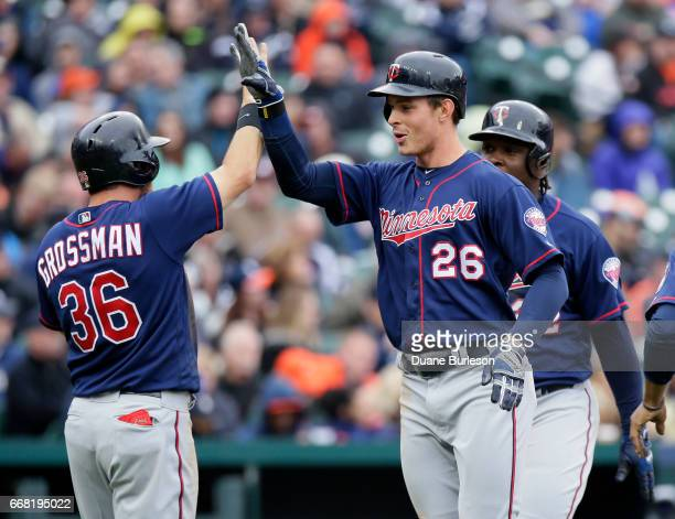 Max Kepler of the Minnesota Twins is congratulated by Robbie Grossman of the Minnesota Twins after hitting a threerun home run that also scored...