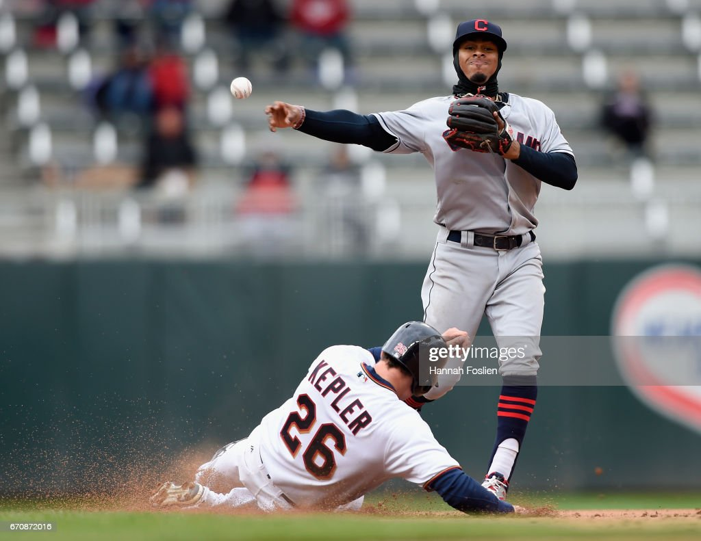 Max Kepler #26 of the Minnesota Twins is out at second base as Francisco Lindor #12 of the Cleveland Indians looks to turn a double play during the eighth inning of the game on April 20, 2017 at Target Field in Minneapolis, Minnesota. The Indians defeated the Twins 6-2.