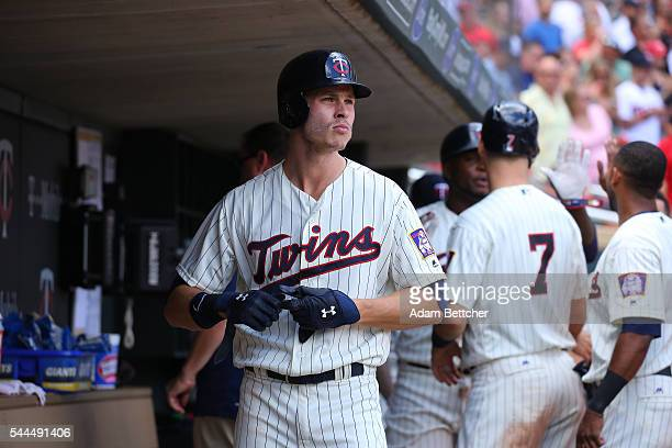 Max Kepler of the Minnesota Twins looks out of the dugout after driving in three runs in the fifth inning against the Texas Rangers at Target Field...