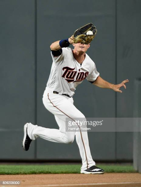 Max Kepler of the Minnesota Twins makes a catch in right field of the ball hit by Adrian Beltre of the Texas Rangers during the ninth inning of the...