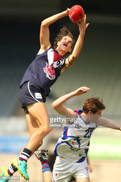 Max King of the Sandringham Dragons competes for the ball over Ethan Phillips of the Oakley Chargers during the 2017 TAC round 01 match between the...