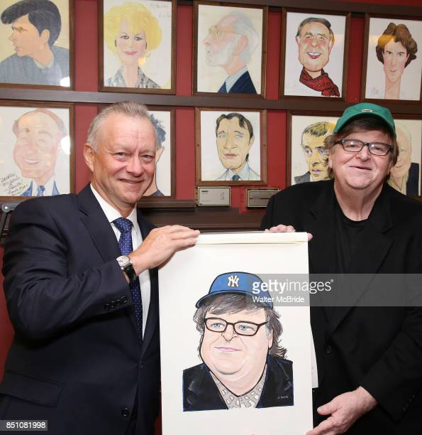 Max Klimavicius and Michael Moore during the Michael Moore And Michael Mayer portrait unveilings as they join the Wall of Fame at Sardi's on...