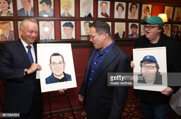 Max Klimavicius Michael Mayer and Michael Moore during the Michael Moore And Michael Mayer portrait unveilings as they join the Wall of Fame at...