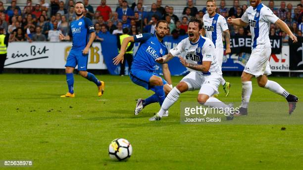 Max Kremer of Meppen challenges Dennis Erdmann of Magdeburg during the 3 Liga match between SV Meppen and 1 FC Magdeburg at Haensch Arena on August 1...