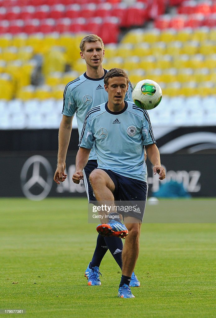 Max Kruse (R) and Per Mersacker of Germany in action during a Germany Training Session at Allianz Arena Munich on September 5, 2013 in Munich, Germany.