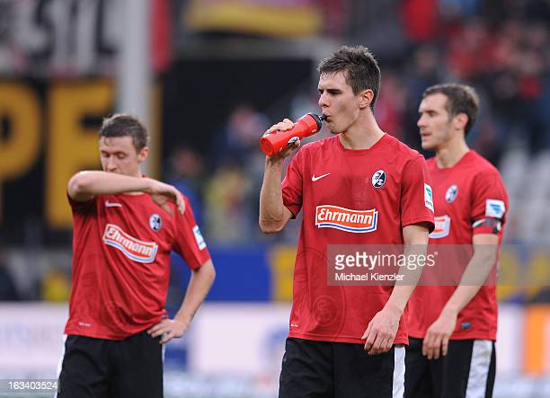 Max Kruse Johannes Flum and Julian Schuster of Freiburg standing disappointed on field after the Bundesliga match between SC Freiburg and VfL...