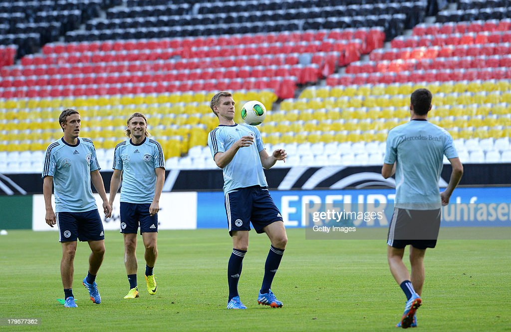 Max Kruse, Marcel Schmelzer and Per Mertsacker of Germany in action during a Germany Training Session at Allianz Arena Munich on September 5, 2013 in Munich, Germany.