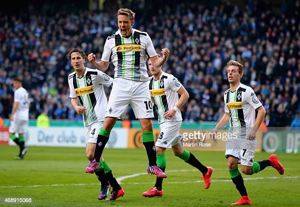 Max Kruse of Borussia Moenchengladbach celebrates as he scores their first goal from a penalty during the DFB Cup Quarter Final match between Arminia...
