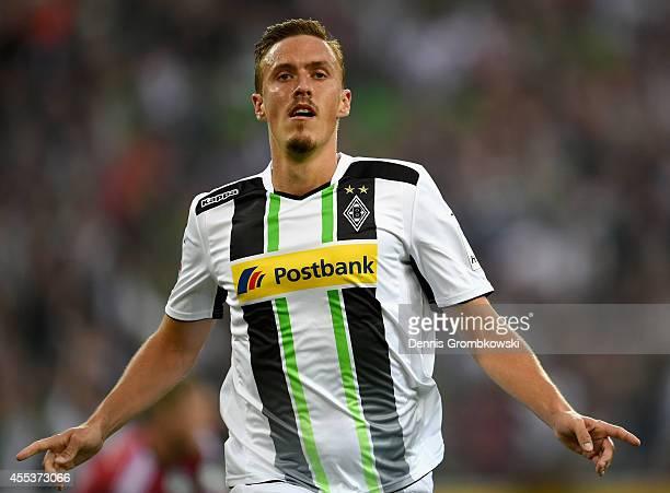 Max Kruse of Borussia Moenchengladbach celebrates scoring the third goal during the Bundesliga match between Borussia Moenchengladbach and FC Schalke...