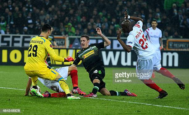 Max Kruse of Borussia Moenchengladbach is blocked by a player of Sevilla as he shoots during the UEFA Europa League Round of 32 second leg match...
