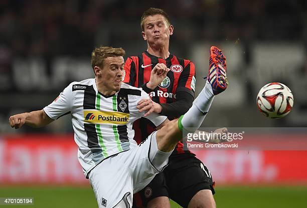 Max Kruse of Borussia Moenchengladbach is challenged by Alexander Madlung of Eintracht Frankfurt during the Bundesliga match between Eintracht...