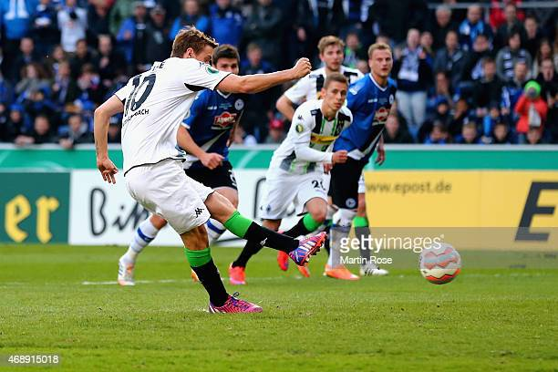 Max Kruse of Borussia Moenchengladbach scores their first goal from a penalty during the DFB Cup Quarter Final match between Arminia Bielefeld and...