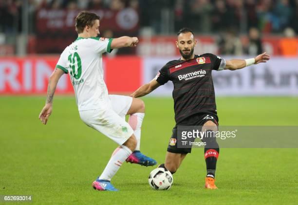 Max Kruse of Bremen and Oemer Toprak of Leverkusen battle for the ball during the Bundesliga soccer match between Bayer Leverkusen and Werder Bremen...