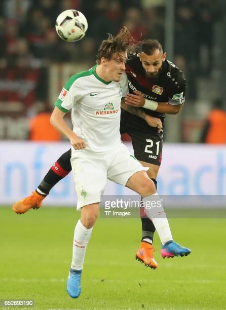 Max Kruse of Bremen and Oemer Toprak of Leverkusen controls the ball during the Bundesliga soccer match between Bayer Leverkusen and Werder Bremen at...