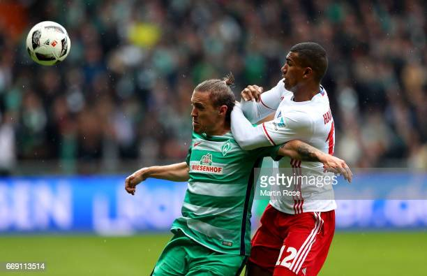 Max Kruse of Bremen and Walace of Hamburg battle for the ball during the Bundesliga match between Werder Bremen and Hamburger SV at Weserstadion on...