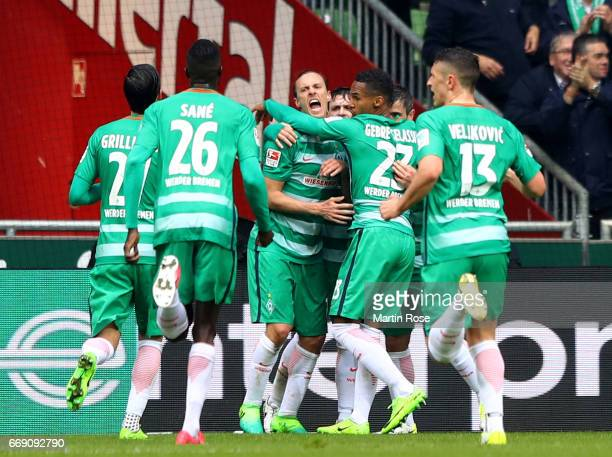 Max Kruse of Bremen celebrate with his team mates after he scores the equalizing goal during the Bundesliga match between Werder Bremen and Hamburger...