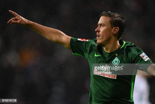 Max Kruse of Bremen celebrates scoring his first goal during the Bundesliga match between SV Werder Bremen and Hannover 96 at Weserstadion on...
