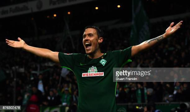 Max Kruse of Bremen celebrates scoring his third goal during the Bundesliga match between SV Werder Bremen and Hannover 96 at Weserstadion on...
