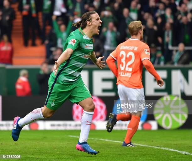 Max Kruse of Bremen celebrates scoring the penalty during the Bundesliga match between Werder Bremen and SV Darmstadt 98 at Weserstadion on March 4...