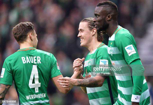 Max Kruse of Bremen celebrates scoring the penalty with Robert Bauer during the Bundesliga match between Werder Bremen and SV Darmstadt 98 at...