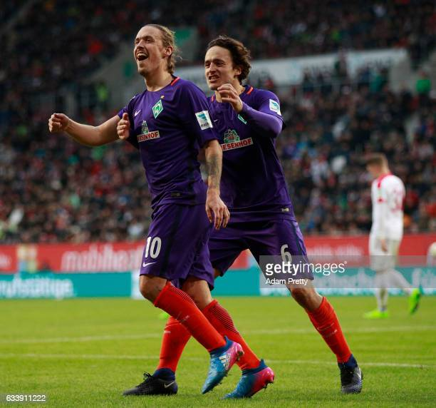 Max Kruse of Bremen celebrates scoring the penalty with Thomas Delaney during the Bundesliga match between FC Augsburg and Werder Bremen at WWK Arena...