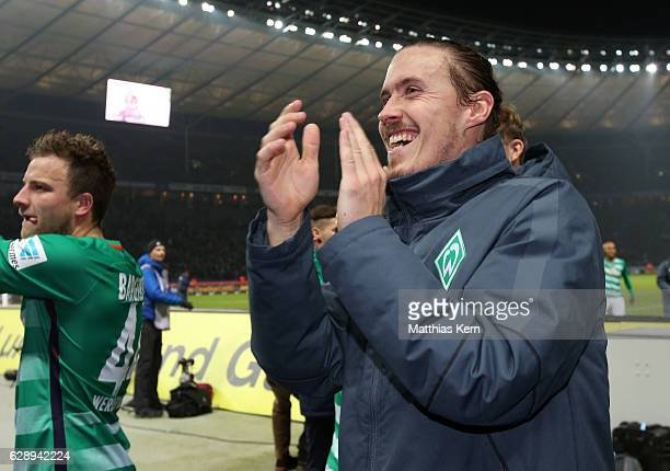 Max Kruse of Bremen celebrates with his supporters after winning the Bundesliga match between Hertha BSC and SV Werder Bremen at Olympiastadion on...