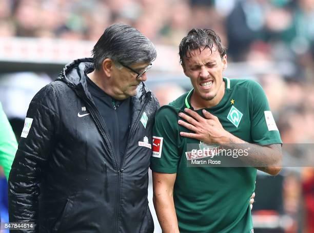 Max Kruse of Bremen has to leave the match injured during the Bundesliga match between SV Werder Bremen and FC Schalke 04 at Weserstadion on...