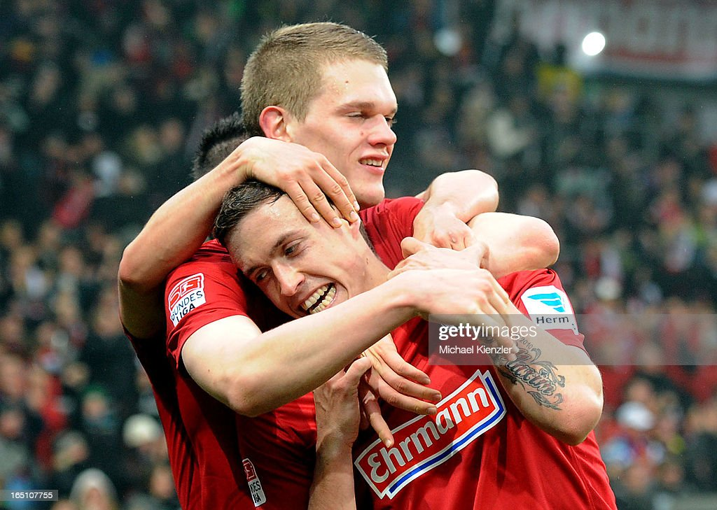 Max Kruse of Freiburg celebrates his second goal with Matthias Ginter (behind) during the Bundesliga match between SC Freiburg and VfL Borussia Moenchengladbach at MAGE SOLAR Stadium on March 30, 2013 in Freiburg, Germany.