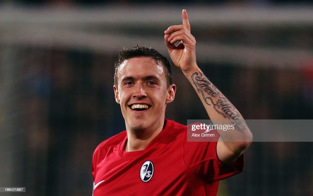 <a gi-track='captionPersonalityLinkClicked' href=/galleries/search?phrase=Max+Kruse&family=editorial&specificpeople=3945507 ng-click='$event.stopPropagation()'>Max Kruse</a> of Freiburg celebrates his team's second goal during the Bundesliga match between SC Freiburg and Hannover 96 at MAGE SOLAR Stadium on April 12, 2013 in Freiburg im Breisgau, Germany.