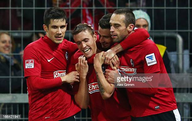 Max Kruse of Freiburg celebrates his team's second goal with team mates Mensur Mujdza Daniel Caligiuri and Pavel Krmas during the Bundesliga match...