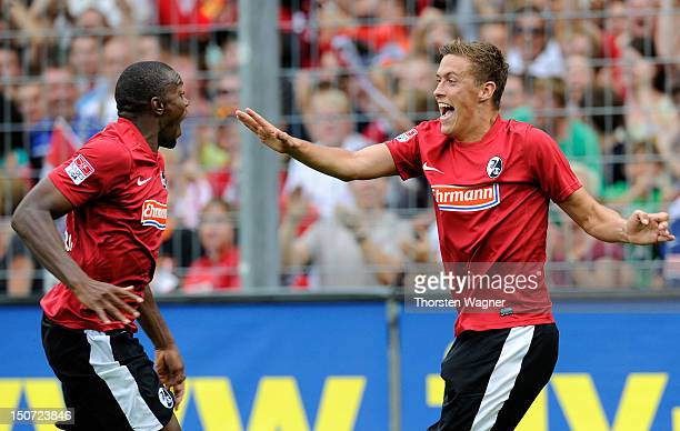 Max Kruse of Freiburg celebrates with his team mate Karim Guede after scoring his teams first goal during the Bundesliga match between SC Freiburg...