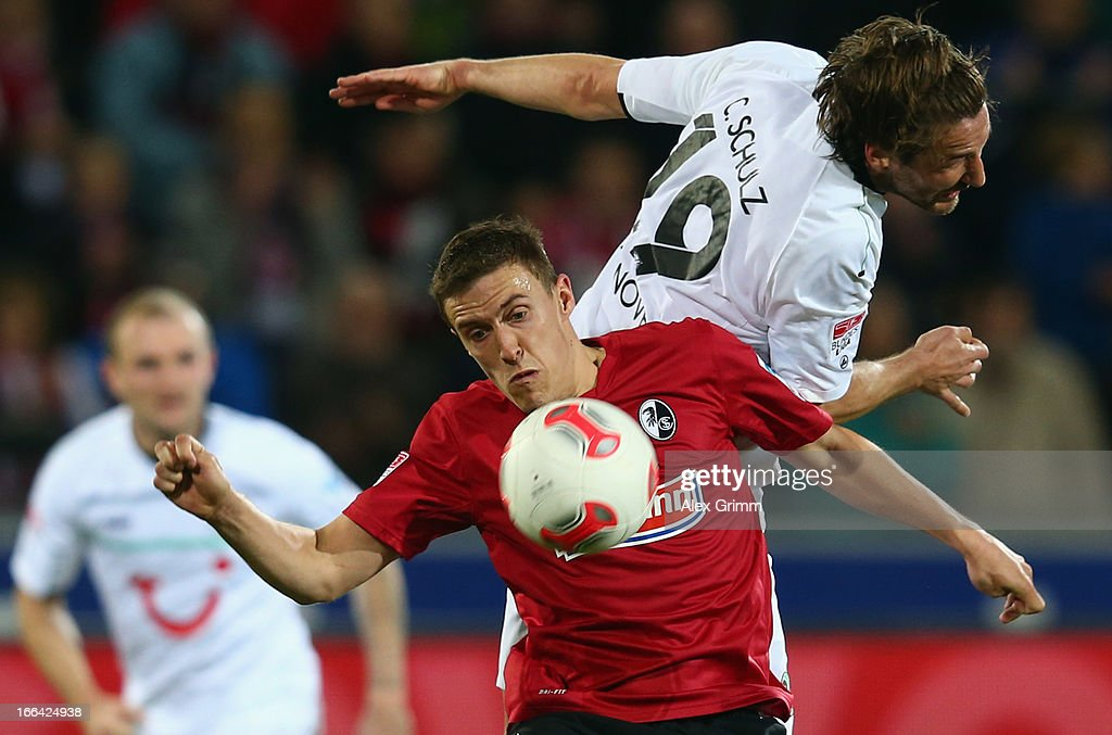 Max Kruse of Freiburg is challenged by Christian Schulz of Hannover during the Bundesliga match between SC Freiburg and Hannover 96 at MAGE SOLAR...