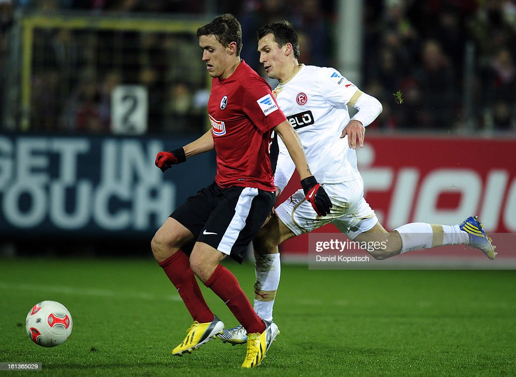 Max Kruse of Freiburg (L) is challenged by Robert Tesche of Duesseldorf during the Bundesliga match between SC Freiburg and Fortuna Duesseldorf 1895 at MAGE SOLAR Stadium on February 10, 2013 in Freiburg im Breisgau, Germany.