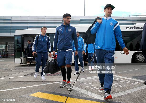 Max Kruse of Germany and his team mates Emre Can and Manuel Neuer boards for the team charter to Leipzig at Dublin airport on October 9 2015 in...