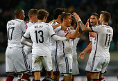 Max Kruse of Germany celebrates with team mates after scoring his team's second goal during the UEFA EURO 2016 Group D qualifying match between...