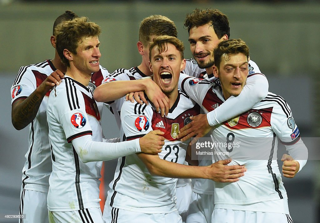 <a gi-track='captionPersonalityLinkClicked' href=/galleries/search?phrase=Max+Kruse&family=editorial&specificpeople=3945507 ng-click='$event.stopPropagation()'>Max Kruse</a> of Germany (23) celebrates with team mates as he scores their second goal during the UEFA EURO 2016 Group D qualifying match between Germany and Georgia at Stadium Leipzig on October 11, 2015 in Leipzig, Germany.