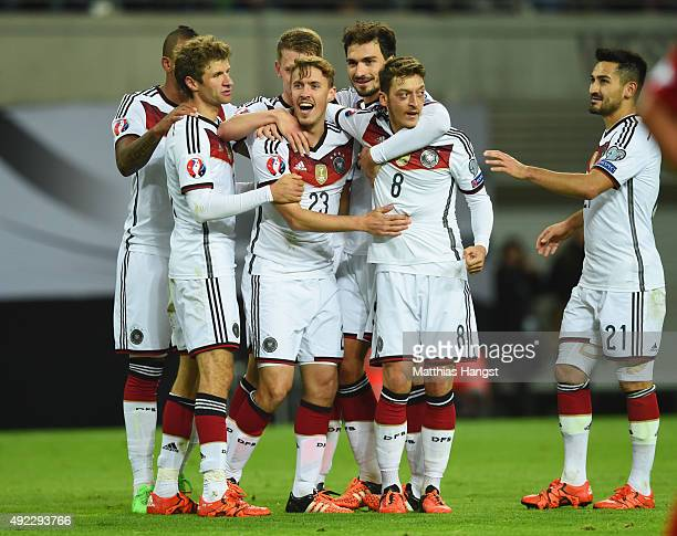 Max Kruse of Germany celebrates with team mates as he scores their second goal during the UEFA EURO 2016 Group D qualifying match between Germany and...