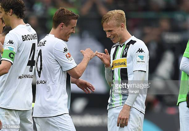 Max Kruse of Gladbach and Oscar Wendt of Gladbach celebrate after the Bundesliga match between Borussia Moenchengladbach and VfL Wolfsburg at...