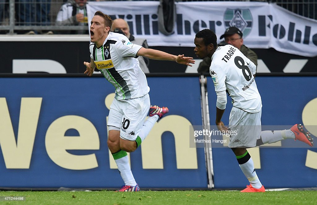 <a gi-track='captionPersonalityLinkClicked' href=/galleries/search?phrase=Max+Kruse&family=editorial&specificpeople=3945507 ng-click='$event.stopPropagation()'>Max Kruse</a> of Gladbach celebrates with his team-mates after scoring his team's first goal during the Bundesliga match between Borussia Moenchengladbach and VfL Wolfsburg at Borussia Park Stadium on April 26, 2015 in Moenchengladbach, Germany.