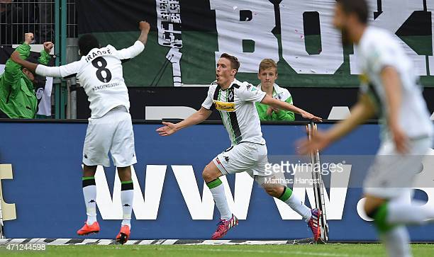 Max Kruse of Gladbach celebrates with his teammates after scoring his team's first goal during the Bundesliga match between Borussia Moenchengladbach...
