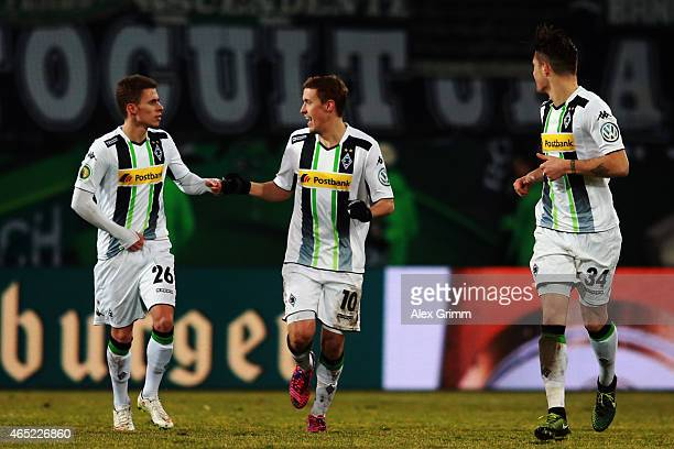 Max Kruse of Moenchengladbach celebrates his team's first goal with team mates Thorgan Hazard and Granit Xhaka during the DFB Cup Round of 16 match...