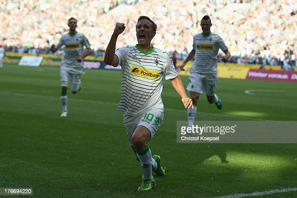 Max Kruse of Moenchengladbach celebrates the first goal during the Bundesliga match between Borussia Moenchengladbach and Hannover 96 at Borussia...