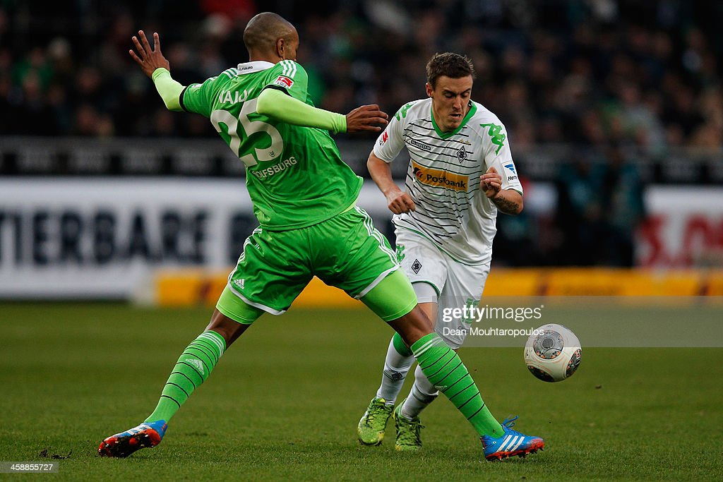<a gi-track='captionPersonalityLinkClicked' href=/galleries/search?phrase=Max+Kruse&family=editorial&specificpeople=3945507 ng-click='$event.stopPropagation()'>Max Kruse</a> of Moenchengladbach is tackled by Naldo of Wolfsburg during the Bundesliga match between Borussia Moenchengladbach and VfL Wolfsburg held at Borussia-Park on December 22, 2013 in Moenchengladbach, Germany.