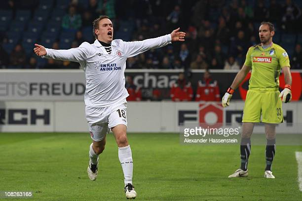 Max Kruse of St Pauli celebrates scoring the first team goal whilst Hoffenheim's keeper Tom Starke looks dejected during the Bundesliga match between...