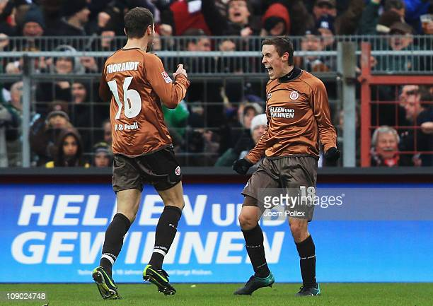 Max Kruse of StPauli celebrates after scoring his team's first goal during the Bundesliga match between FC StPauli and Borussia Moenchengladbach at...