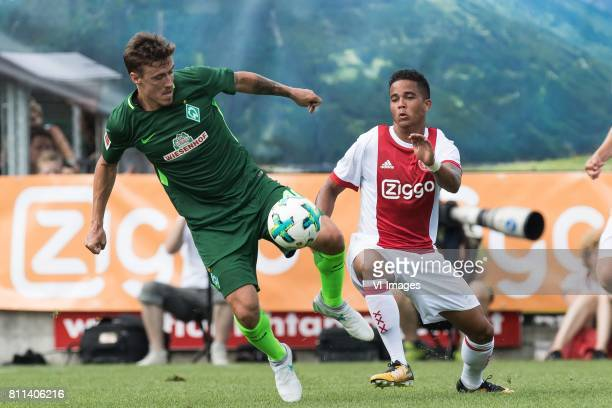 Max Kruse of SV Werder Bremen Justin Kluivert of Ajax during the friendly match between Ajax Amsterdam and SV Werder Bremen at Lindenstadion on July...
