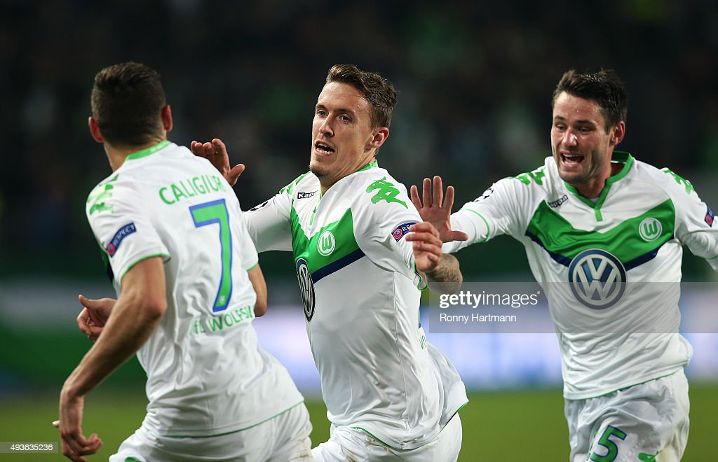 Max Kruse (C) of VfL Wolfsburg celebrates after scoring his team's second goal with Daniel Caligiuri (L) and Christian Traesch during the UEFA Champions League Group B match against PSV Eindhoven at Volkswagen Arena on October 21, 2015 in Wolfsburg, Germany.