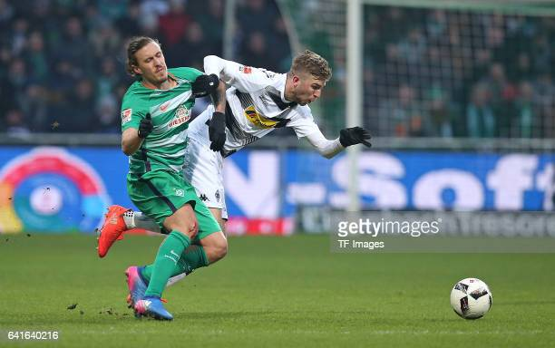 Max Kruse of Werder Bremen and Christoph Kramer of Moenchengladbach battle for the ball during the Bundesliga match between Werder Bremen and...